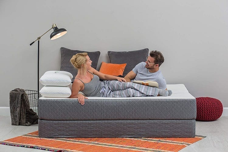 Young Couple Laying On Mattress