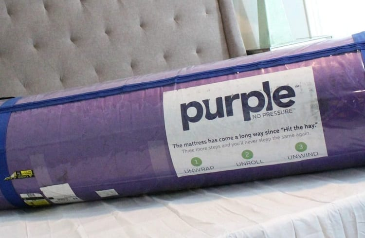 Bagged Purple Mattress On Bed